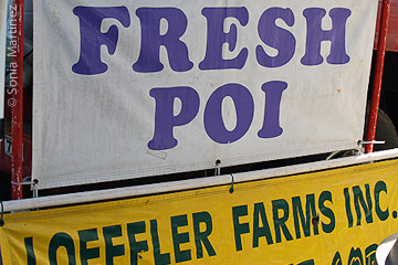 Waipi'o poi sold by Loeffler Farms together with fresh corn, fish, and other produce.