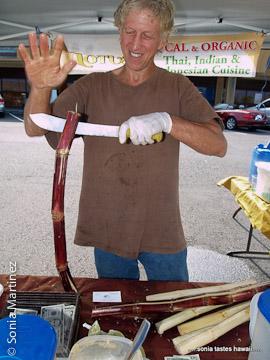 Howie Simon prepares sugarcane for juicing.