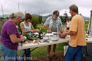 Workshop participants prepare food harvested from the garden at Mala'ai