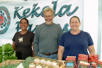 Paul Johnston, Betsy Sanderson and Esko Dakamas at Kekela Farms booth.