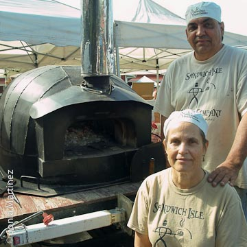 Kay and Kevin Cabreras of Sandwich Isles Bread Company with Matilda, their traveling brick oven.