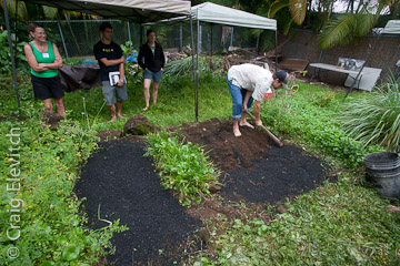 Hunt demonstrated techniques for incorporating biochar into a garden bed at Holuakoa Cafe in Holualoa.