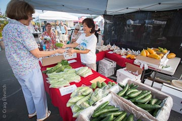 The popular Roy Y. Honda Farm stall at Keauhou Farmers Market sells Roy's signature tomatoes and many other vegetables and fruits.