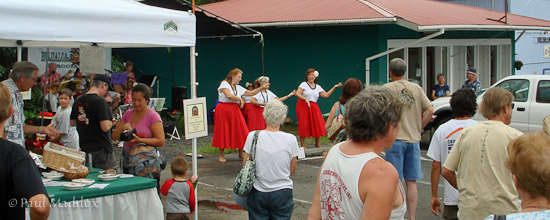 Music and dance performance at Holualoa post office.