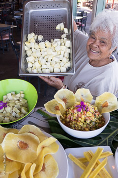 Auntie Shirley Kauhaihao displays Sam Choy breadfruit dishes.
